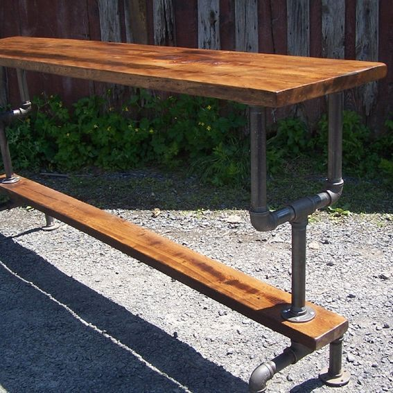 Custom Made Industrial Styled Bar Height Table With A Metal Pipe Base And Salvaged Wood Planks Top