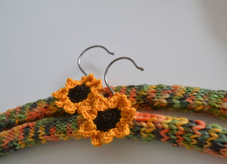 Knitting Coat Hangers : Knitted covered coat hangers with crocheted sunflowers