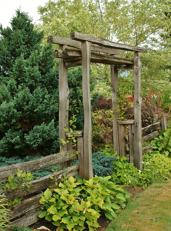 No link here, but a great photo of a rustic arbor/ gate. Nice way to section backyard.