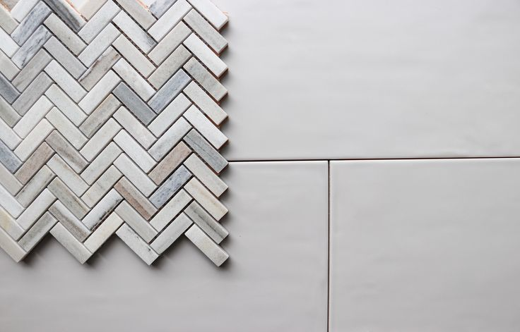 Make your room pop by mixing your finishes and sizes, such as pairing oversized matte tiles with intricately-coloured polished mosaics.