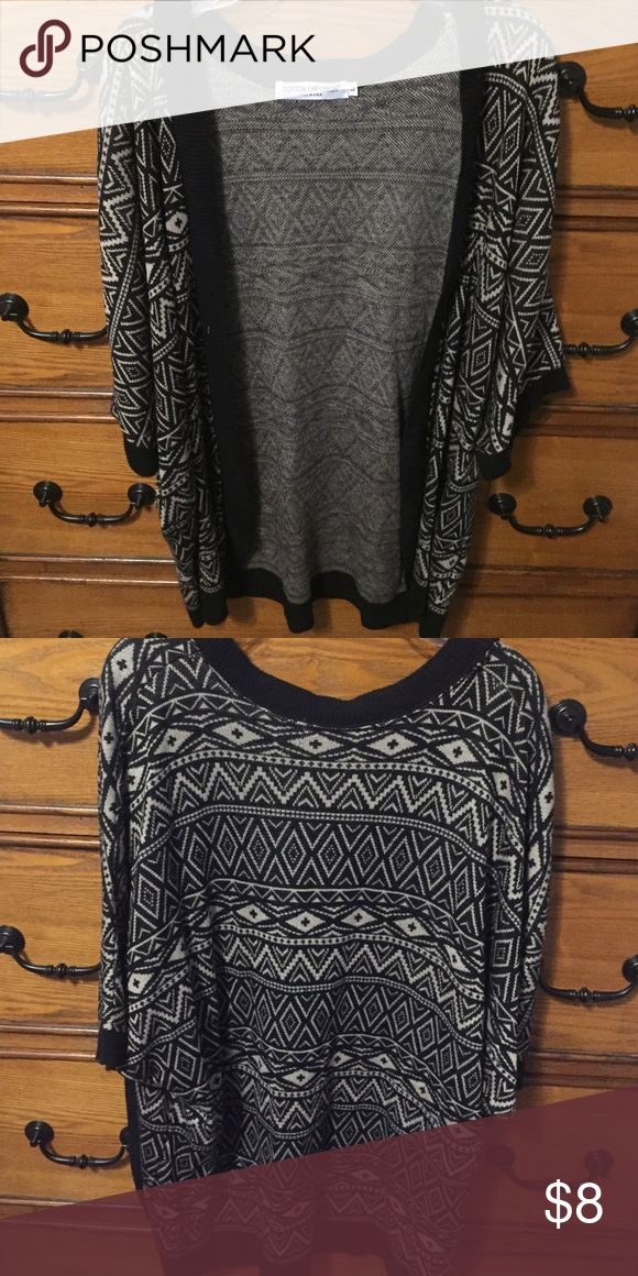 3/4 Sleeve Neutral Tribal Print Cardigan Cute tribal print Cardigan that is versatile and perfect for fall and winter. Size is large. Brand is Cotton Emporium. Minimal wear. Great condition. Cotton Emporium Sweaters Cardigans
