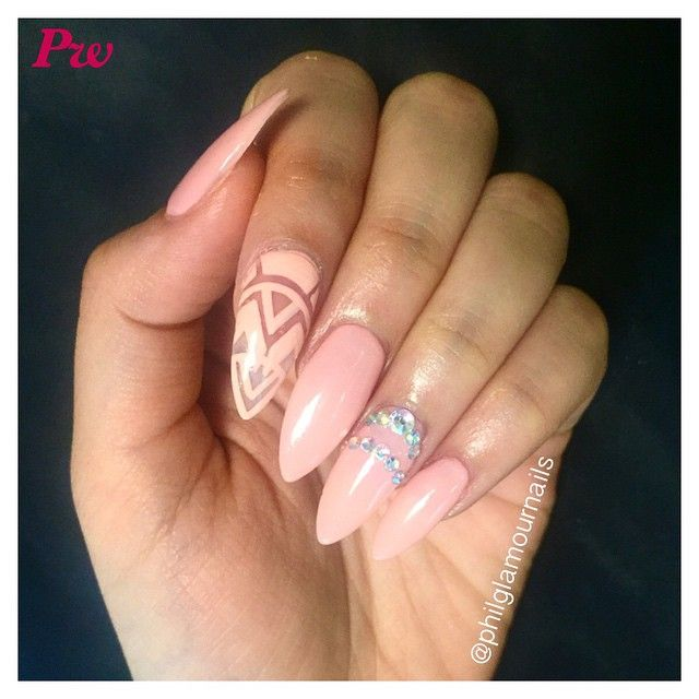 Pink stiletto nails with negative space design