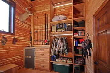Hunting Closet in Garage Addition rustic closet.  The ultimate guy room.