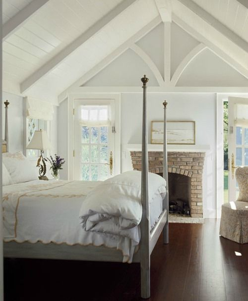 fireplace in traditional bedroom by Austin Patterson Disston  Architects-like the white plank ceiling