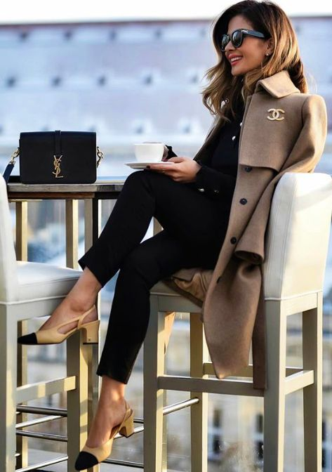 Love the Chanel pin and the black and beige. Oh and the YSL bag!