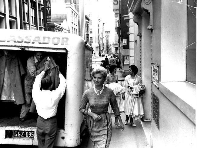 1961: A woman walking down Flinders Lane in Melbourne. Picture: Herald Sun Image Library