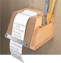 A Note Caddy!  I need one!  I'm always looking for a tablet (for some reason...they're always missing...and finding something to write with..that's next to impossible.  This would solve my problem!