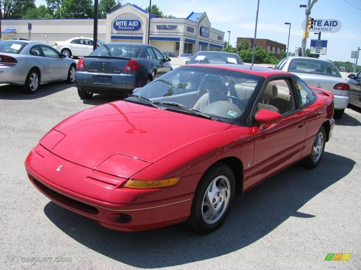 1996 Bright Red Saturn S Series SC2 Coupe.