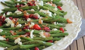 Green Beans with Cranberries, Bacon and Goat cheese :http://www.runningtothekitchen.com/green-beans-cranberries-bacon-goat-cheese-2/