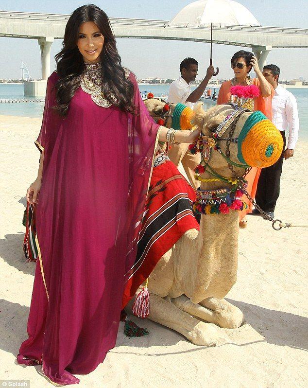 kim kardashian in Dubai...in an ABAYA.  She looks so classy covered up for once.
