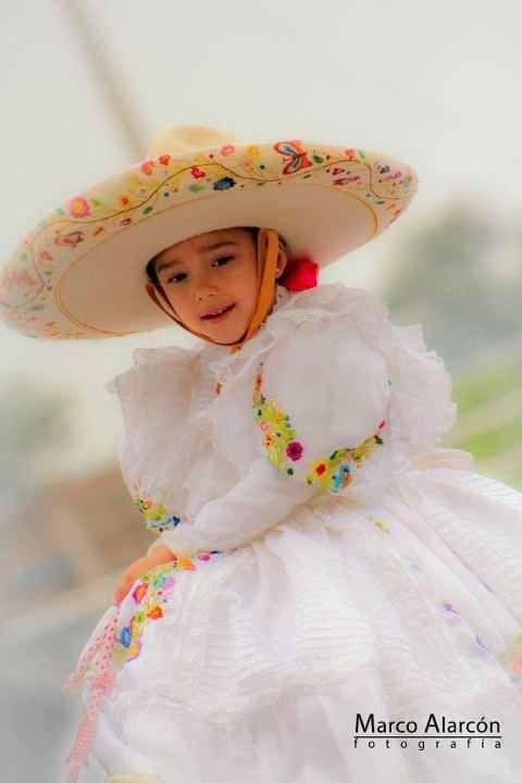 Escaramuza - a young girl riding side-saddle. She's so adorable! Jalisco, Mex.