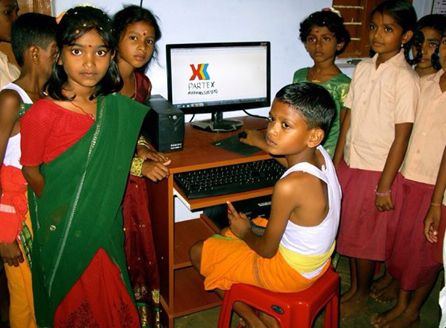 Village children using the IT facilities in the newly opened citizen centre