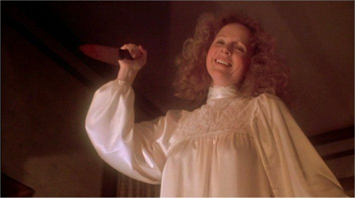 Piper Laurie as Carrie's fanatic Mother -