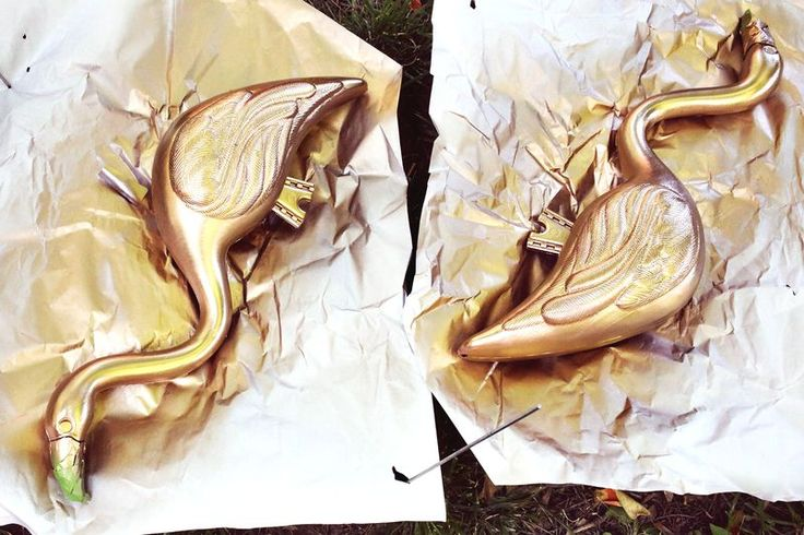 gold spray painted lawn flamingos  via A Beautiful Mess