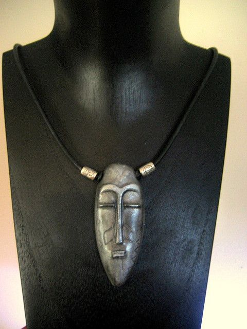 https://flic.kr/p/3ks6nt | Polymer clay Tribal Mask Pendant | Polymer clay, silver mica powder, black buna cord and silver metal beads.