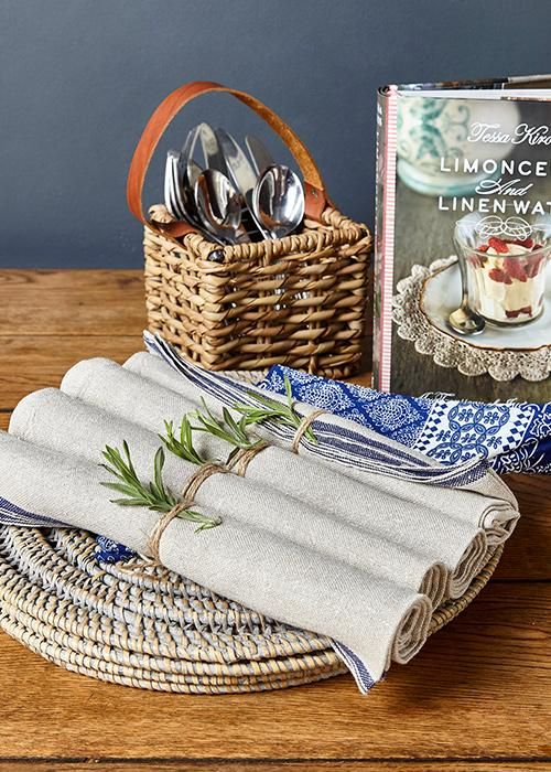 France, Italy, Mediterranean? Delectable Italian Recipes, French linen Napkins, grey-wash rattan placemats and a hand-woven cutlery holder. Set the table, Dinner is served.