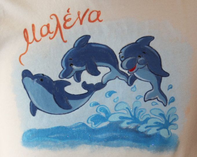 Hand painted t shirt. I use non-toxic, water based, permanent fabric colors. | Three dolphins jumping off the water. The girl's name -Malena - is written in Greek.