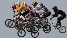 BMX bikers take to the air during the men's event at the London Olympics