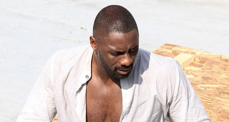 Idris Elba unbuttoned his shirt during a warm day on set for #TheDarkTower:
