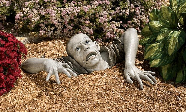 """Unusual garden ornaments by Design Toscano - this is about the strangest one I have seen yet.  """"Zombie""""."""