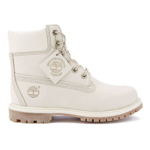 Timberland Women's 6 Inch Premium Boots - Winter White Waterbuck ($110) ❤ liked on Polyvore featuring shoes, boots, white, white boots, flat boots, ivory shoes, water proof shoes and waterproof boots