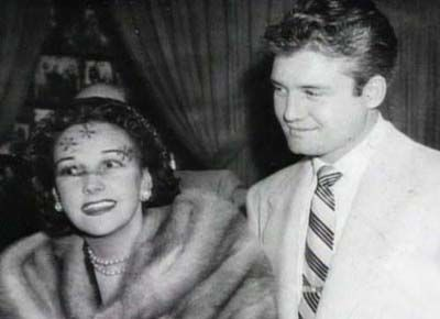 George Reeves and Toni Mannix.  She was the wife of MGM Manager Eddie Mannix, and lover of George Reeves.  She purchased the home at 1579 Benedict Canyon Dr. as a gift for him.