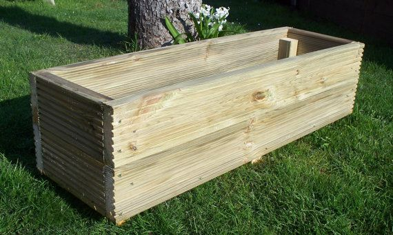 Large handmade wooden garden decking planters,  Made from extra thick 32mm pressure treated tanalised timber The corner are fixed using 2.5 inch,