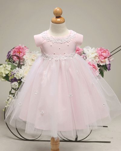 Adorable baby pink dress with tulle skirt and boat neck bodice