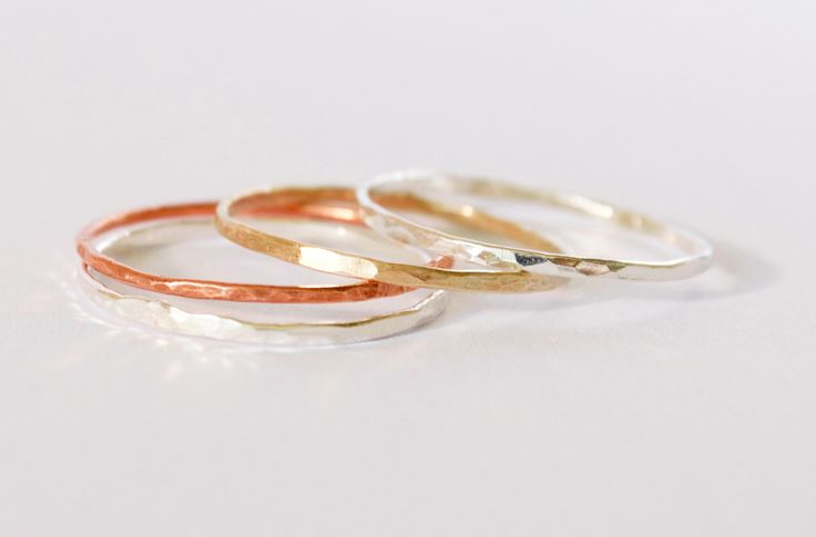Delicate stacker ring set by Tic Tic Boom Design, with two sterling silver, one 9ct rose gold, one 9ct yellow gold and one copper, all hand made with a light hammered textured pattern #foundonfelt #aklfair #newzealandmade #pinandwin