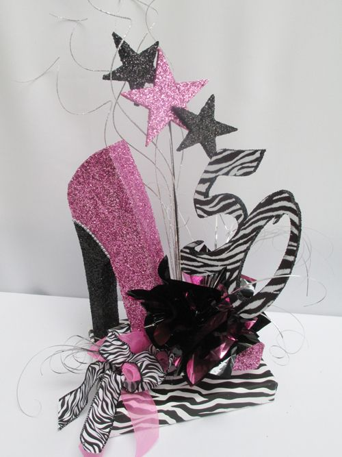 Each time we do our custom high heel shoe cutout it takes on another look. This one is definitely for the zebra lovers. Glittered hot pink with a black glittered heel and accented with some rhinest...