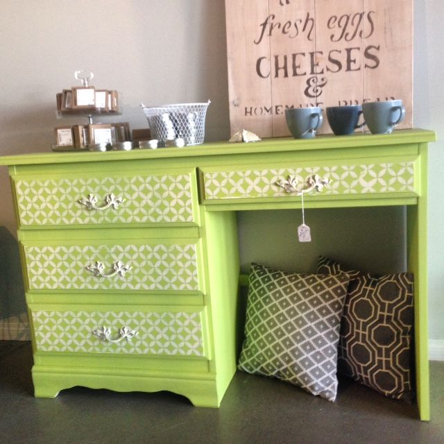 Reloved desk with stencil design on drawers available at 123 3 Ave. S.W. High River, AB.  A Little Of This.  Please like our facebook page:   https://www.facebook.com/alittleofthishighriver #alittleofthishighriver #relovedfurniture #repurposed #painted #stenciled #green