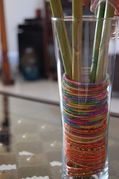 Love the bangles inside the cylinder. Could do twigs for the center, or a candle, or a sign sticking out that says something about boots or fashion or connecting with girlfriends :0)