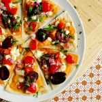 Greek Nachos ~ pita bread (or tortillas) with hummus, feta, olives, onions, tomatoes!!! Step-by-step directions with GREAT pictures!