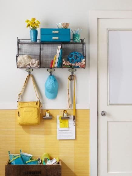 Small wonder: For homes with small entry areas, adapt wall space to organize day-to-day items. Hanging baskets collect grab-and-go pieces like toys and scarves. You'll never forget important papers thanks to the handy clipboards near the door.