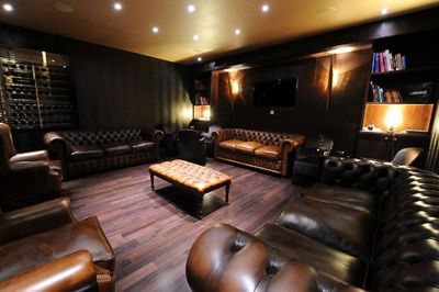 Old world leather. Old world cigar rolling traditions.    Cigar room.