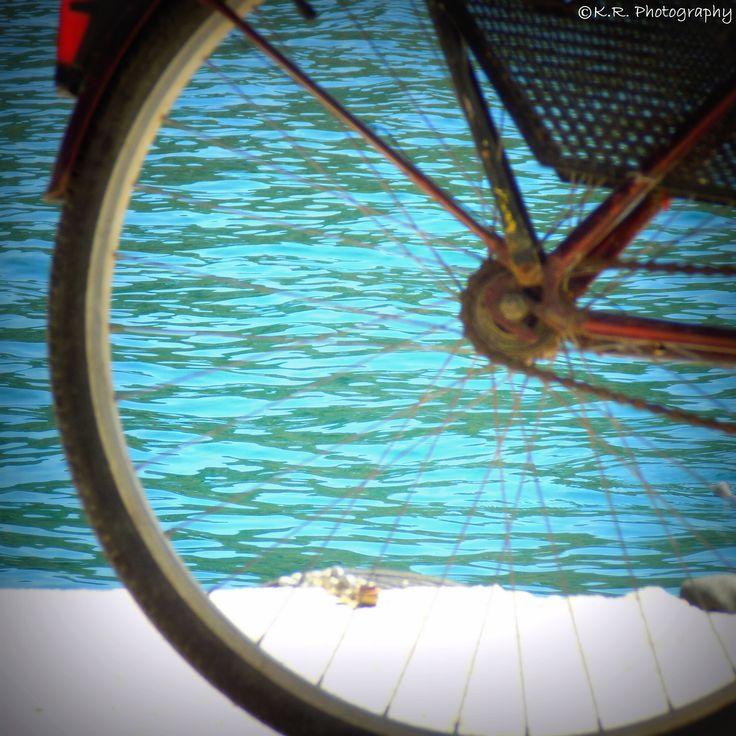 Behind a bicycle wheel