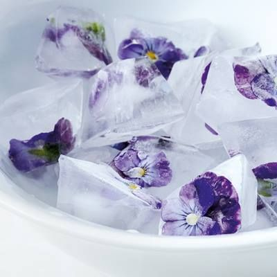 GOOD IDEA: Make ice cubes with edible flowers inside and place them in a jug filled with water for a pretty element on a summer table.