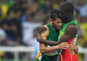 Second-placed Kirani James of Grenada embraces Wayde van Niekerk after he broke the world record to take gold.