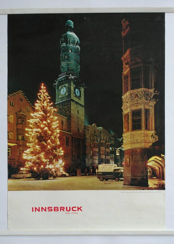 A beautiful travel poster promoting the city of Innsbruck located in western part of Austria.  The area is also known as Tirol which is a stunning mountainous area with many skiing slopes, magnificent old buildings and a very rich culture. The poster displays the older cityscape of Innsbruck around Christmas. By looking at the cars on the photo it is easy to see that this picture was taken many years ago.  The poster was publish by Tourist Office Innsbruck-Igls (Fremdenverkehrband…