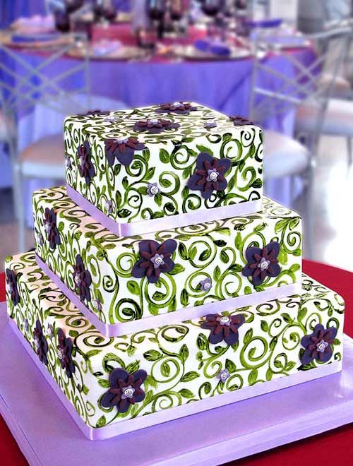 Four tier hexagon shape purple oriental wedding cake, decorated with intricate purple decorations, fresh purple and lilac flowers and Chinese double happiness symbols. Description from perfect-wedding-day.com. I searched for this on bing.com/images