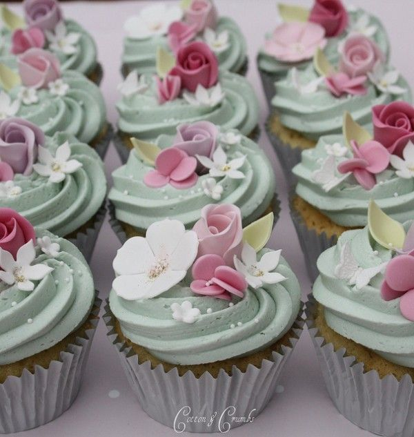 Loving the pale green buttercream cupcakes topped with roses, hydrangea, simple daisies, nonpariels and stephanotis