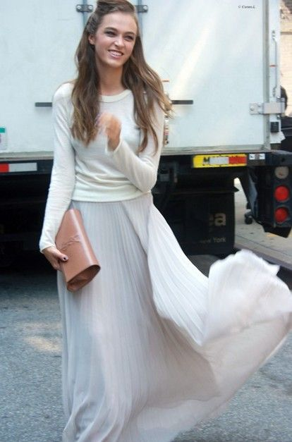 Pair a flowing white skirt with a white top and neutral clutch for a fabulously feminine look.