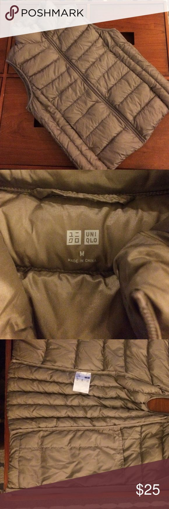 Uniqlo ultra light down puffer vest in grey NWOT. cozy and warm. Outer pockets are pretty cool. Inner pockets are the bomb! Uniqlo Jackets & Coats Vests
