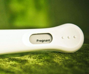 "I took a digital pregnancy test so it said ""pregnant"" -- and we took a picture. I cropped it and made it my profile picture on Facebook. Facebook posts an alert when friends change their profile pictures, so my ""wall"" and Facebook inbox were instantly flooded with congrats messages. Too fun! -- Jessica T., Nashville, Tennessee"