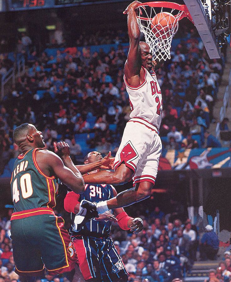 """Michael Jordan in the Air Jordan XII """"Playoffs"""" dunking on Hakeem and Kemp in the 1997 NBA All Star Game"""