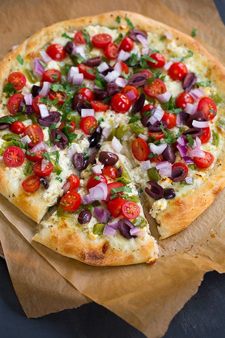 Greek Pizza  - covered with feta, mozzarella, grape tomatoes, red onion, bell pepper, kalamata olives, garlic and parsley. So so good!
