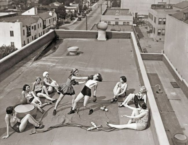 Girls practicing boxing on the roof in 1930