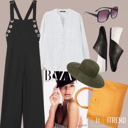 Шляпа добавляет элегантный штрих образу, а яркая сумочка разбавляет строгие черно-белые цвета.