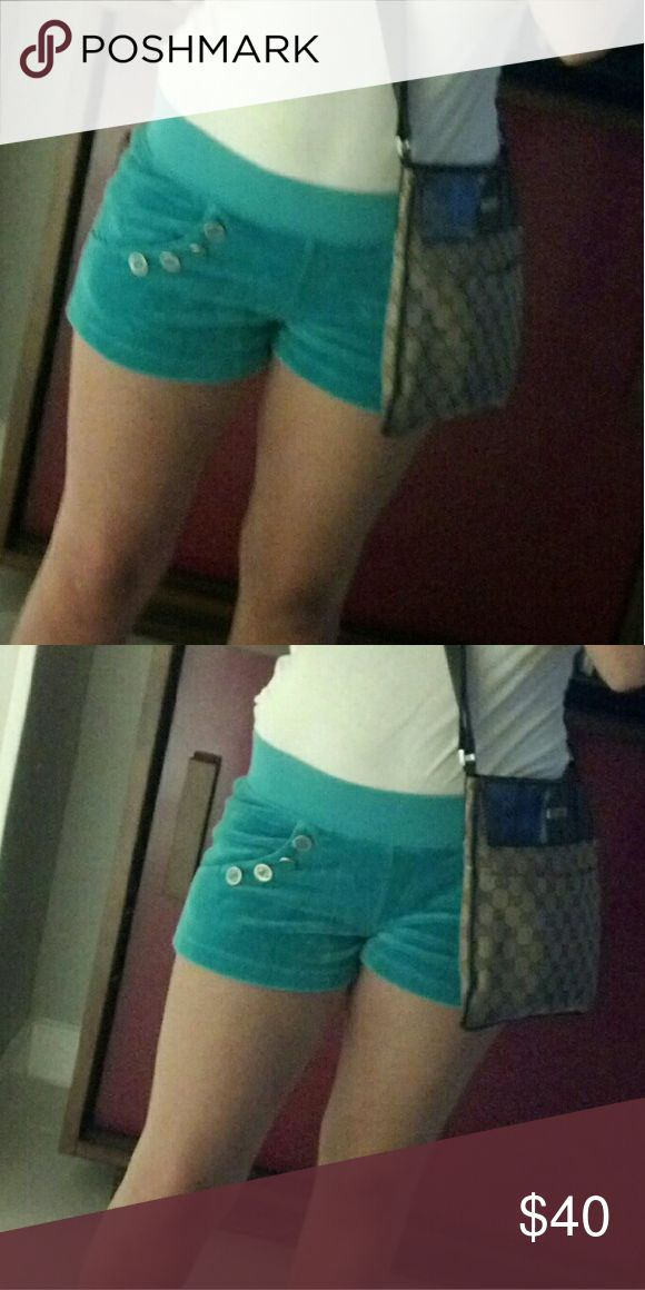 Juicy couture velour short Turquoise velour shorts. With pockets and 4 gold buttons on each side. In great condition and super cute. Size P! Juicy Couture Shorts