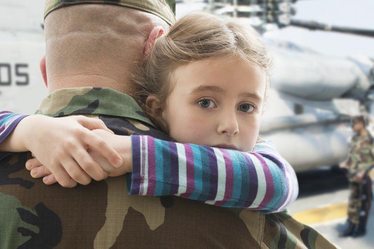 Caucasian returning soldier hugging daughter near helicopter - Caucasian returning soldier hugging daughter near helicopter